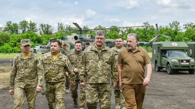Ukrainian President Petro Poroshenko meets servicemen during a visit to Donetsk region in June