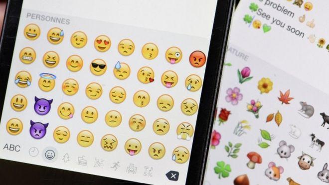 Emoji icons on smartphone screen