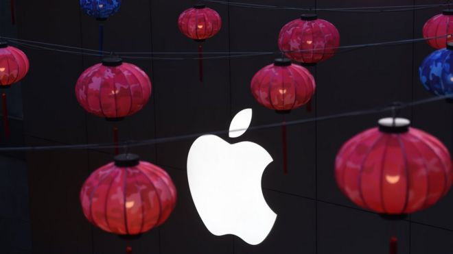 Lanterns hanging in front of Apple logo