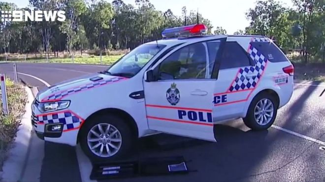 Queensland police officer shot dead as 'wanted man' evades traffic stop
