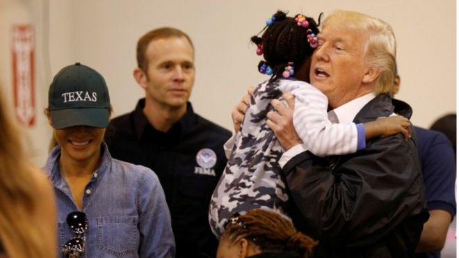 President Donald Trump and First Lady Melania Trump greet children at a centre for flood survivors of Hurricane Harvey, in Houston, Texas,