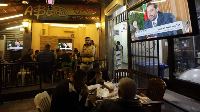 Lebanese watch an interview with Saad Hariri at a coffee shop in Beirut