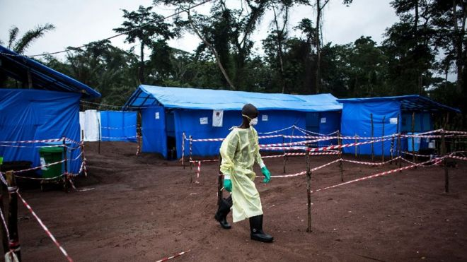 A health worker walks at an Ebola quarantine unit in the DR Congo