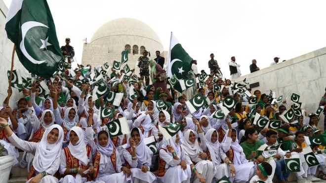 Pakistani girls attend a ceremony at the mausoleum of founder of Pakistan, Muhammad Ali Jinnah, as national celebrates the Independence Day, in Karachi, Pakistan, 14 August 2017