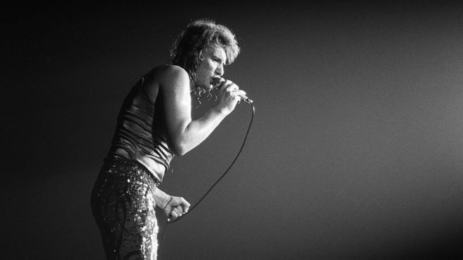 This file photo taken on September 28, 1971 shows French singer Johnny Hallyday performing on stage at the Palais des Sports