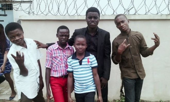 Okina with some of the street children