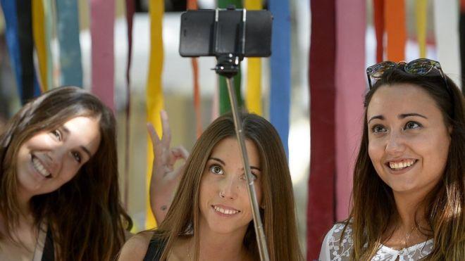 Girls take a selfie in Spain