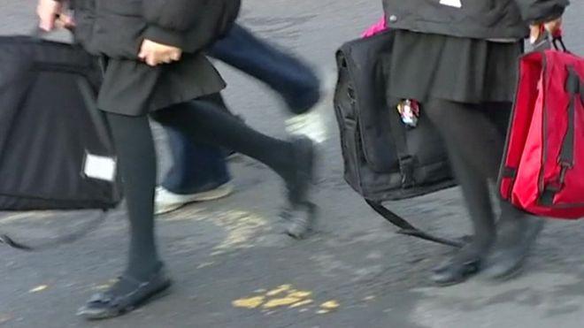 Girls walking into school
