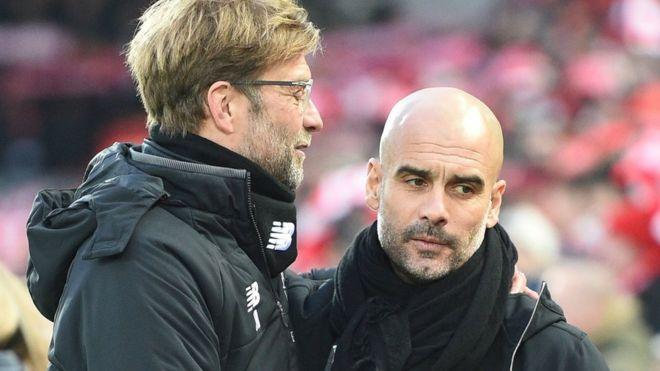 Manchester City manager Pep Guardiola (right) with Liverpool boss Jurgen Klopp