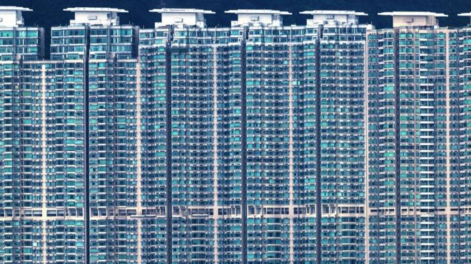 A residential building complex is seen on Hong Kong's outlying Lantau Island on August 16, 2017.