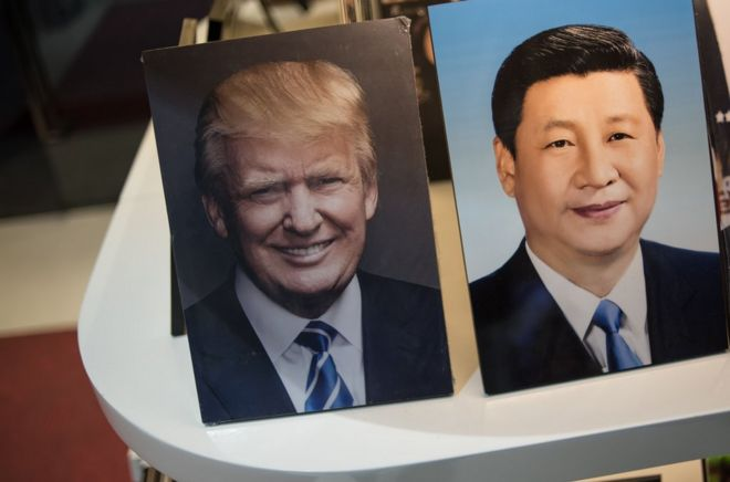Framed photographs of Chinese President Xi Jinping (R) and US President Donald Trump are seen on display in a photo shop in Beijing on November 6, 2017. Donald Trump arrives in China on November 8, which is the third stop of his tour in Asia. / AFP PHOTO / FRED DUFOURFRED DUFOUR/AFP/Getty Images
