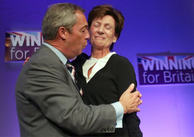 Outgoing leader Nigel Farage embraces Diane James