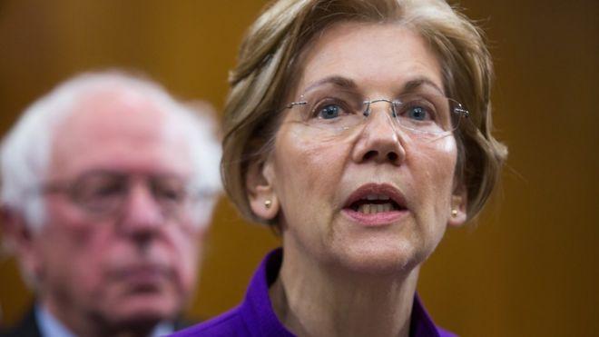 Elizabeth Warren and Bernie Sanders appear together at a news conference.