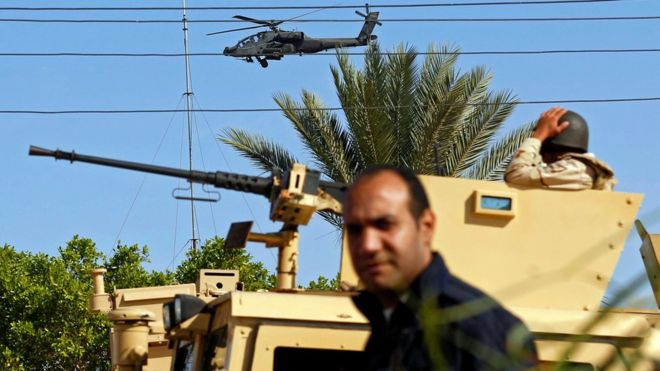 Military forces and helicopters secure an area in North Sinai, Egypt, 1 December 2017.