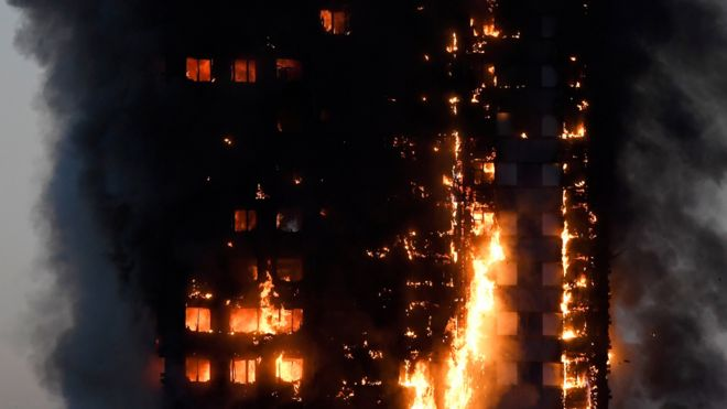 Flames and smoke billow out of Grenfell Tower