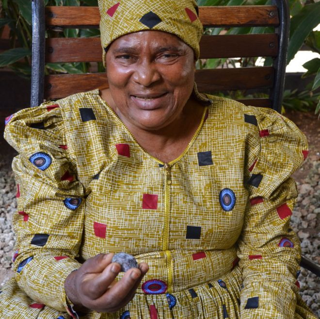 Pili Hussein pictured with a piece of tanzanite
