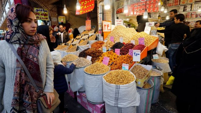 A shopper passes a food stall in Tehran's Grand Bazaar.