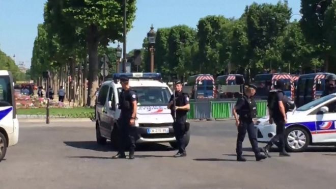 Police patrol security cordon on Champs Elysee in Paris on 19 June