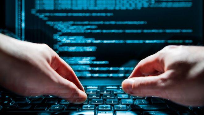 A man's hands at computer
