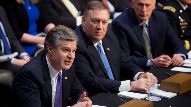 Christopher Wray, director del FBI (izq.), Mike Pompeo, director de la CIA (centro), y Dan Coats, director of Inteligencia Nacional.