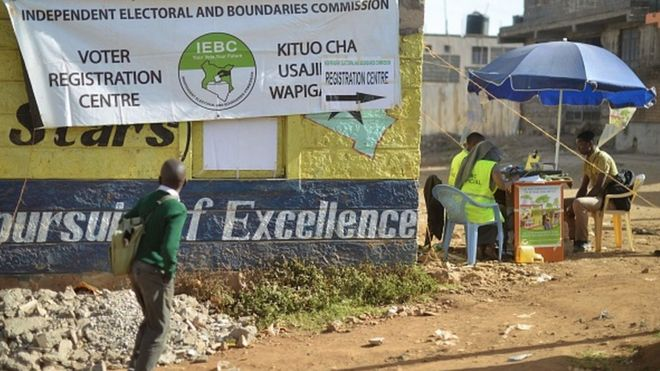 A school boy looks at a banner advertising a voter-registration point January 18, 2017