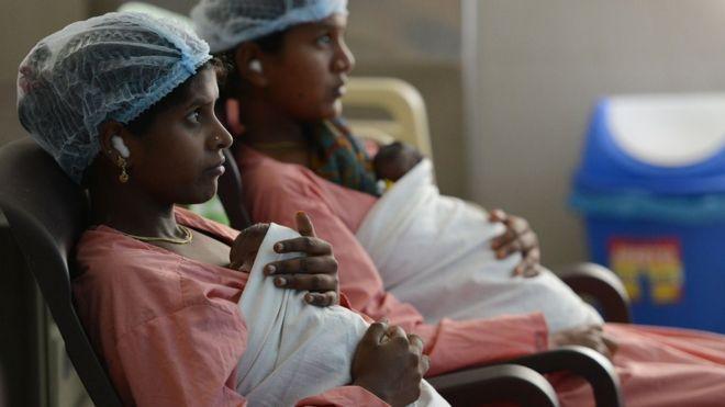 women with newborn babies in a maternity ward