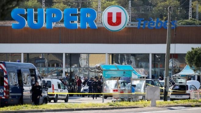 A general view shows gendarmes and police officers at a supermarket after a hostage situation in Trebes, France, on 23 March 2018