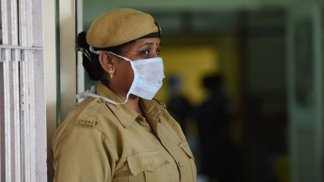 An Indian security guard at the entrance of the swine flu isolation ward in Ahmedabad.