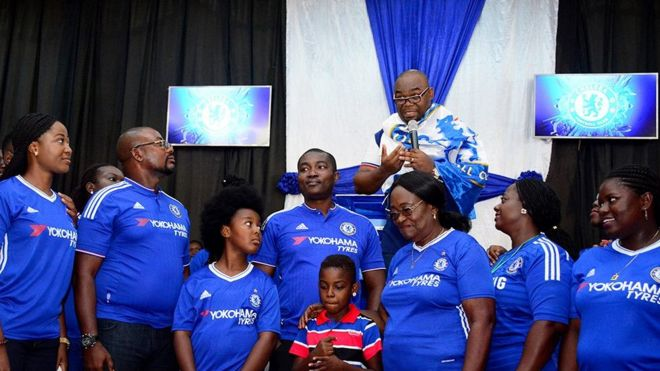 Pastor with his congregants in Chelsea shirts