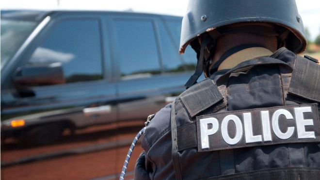 A photo of a Uganda police officer wearing a protective jacket