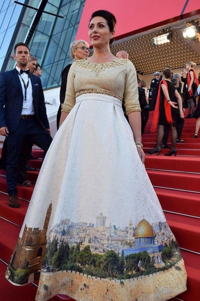 Israeli Culture Minister Miri Regev wearing a dress featuring the old city of Jerusalem arrives on May 17, 2017 for the screening of the film