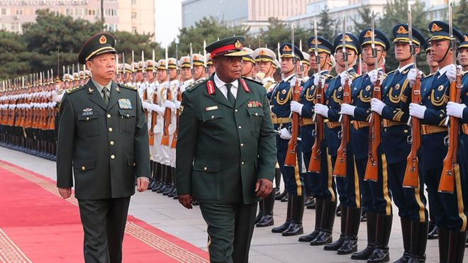 General Li Zuocheng, of China, and General Constantine Guveya Chiwenga, of Zimbabwe