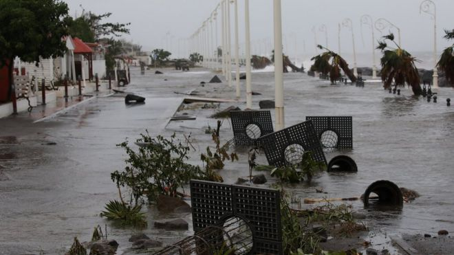 Debris on a flooded seafront after Hurricane Maria in Basse-Terre, Guadeloupe.
