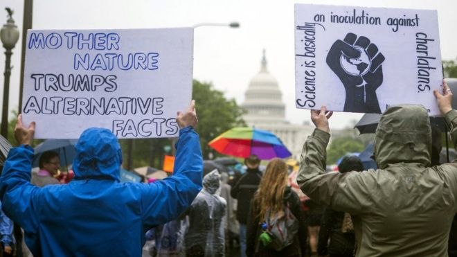 Scientists and supporters participate in a March for Science in Washington DC, 22 April 2017