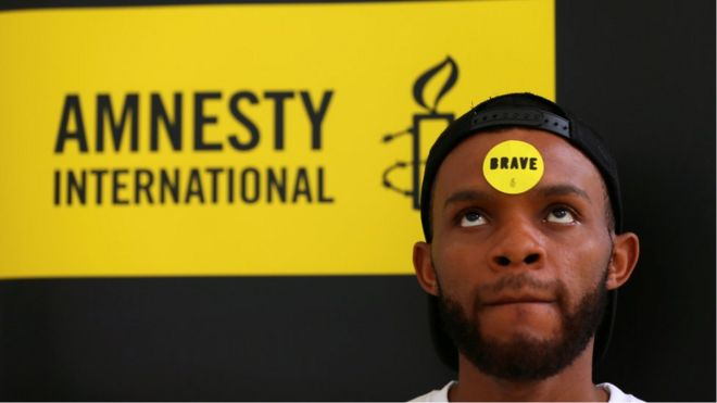 Human rights campaigner looks on during the release of an Amnesty International report in Abuja, Nigeria May 16, 2017