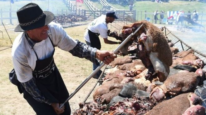 "A total of 16,500 kg of beef are grilled in Rodo Park in Minas, Uruguay, 120 km from Montevideo, in an attempt to break the Guinness record for ""The World's Biggest Barbecue"", on 10 December, 2017"