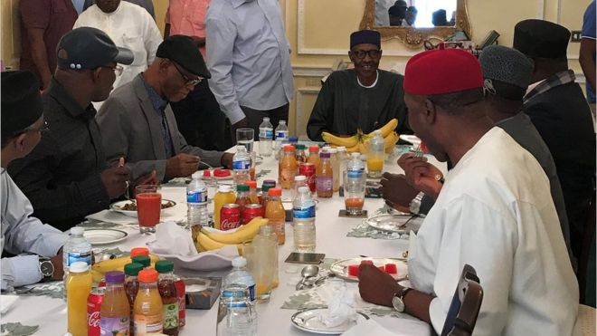 Nigeria's President Muhammadu Buhari (centre) having lunch in Abuja House in London