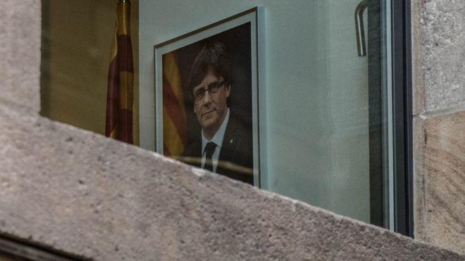portrait of Carles Puigdemont seen through a window of the Palau de la Generalitat, 30 October 2017