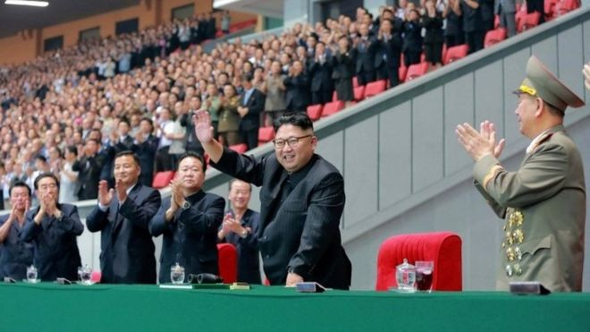 "This August 28, 2016 picture released by North Korea""s official Korean Central News Agency (KCNA) on August 29, 2016 shows North Korean leader Kim Jong-Un (C) waving while attending a torchlight gala of members of the youth vanguard ""Let the Youth Power March forward Following the Party!"" at the May Day Stadium to mark the 9th Congress of the Kim Il Sung Socialist Youth League"