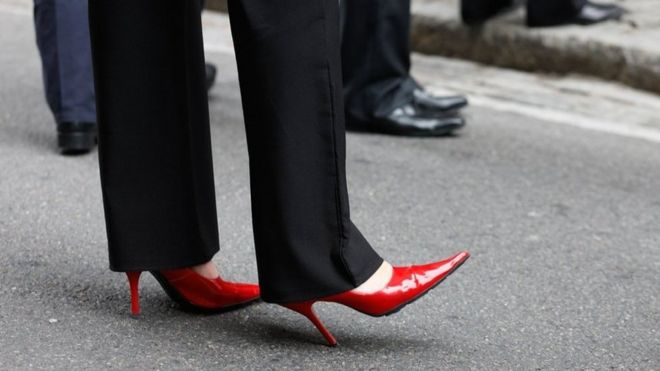 Is it legal to force women to wear high heels at work? - BBC News