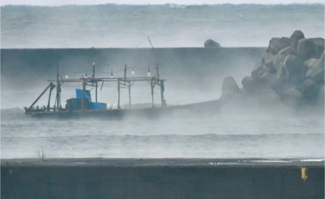 A wooden boat is seen in front of a breakwater in Yurihonjo, Akita Prefecture, Japan November 24, 2017.