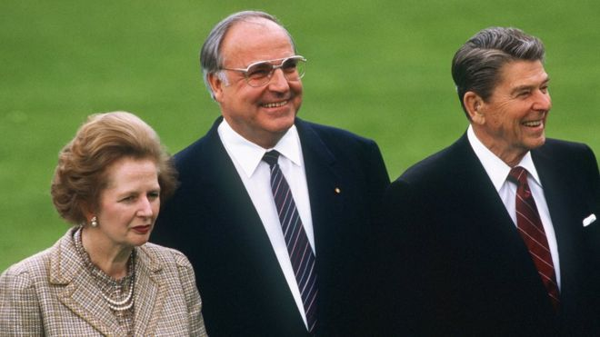 A file picture dated 03 May 1985 shows (L-R) British Prime Minister Margaret Thatcher, German Chancellor Helmut Kohl and US President Ronald Reagan attending an event at the World Economic summit in Bonn, Germany