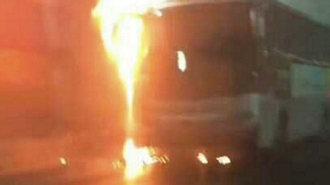 Photo taken with a smartphone shows school bus on fire in Taojiakuang tunnel, Weihai, Shandong Province, China. 9 May 2017