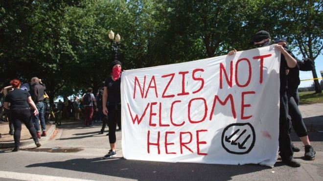 "Antifa protesters with a ""Nazis not welcome here"" banner"