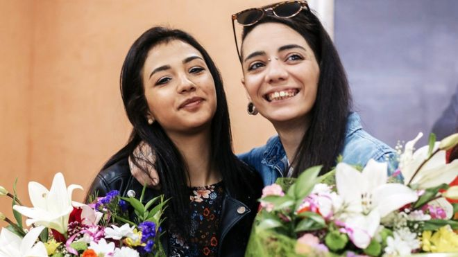 Spaniard Maria Jimena Rico and her Egyptian girlfriend Shaza Ismail pose for photographers as they attend a press conference at the city hall of Torrox, near Malaga, southern Spain, 02 May 2017