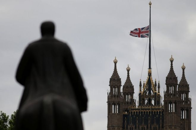 Flag flying at half mast above the Houses of Parliament.