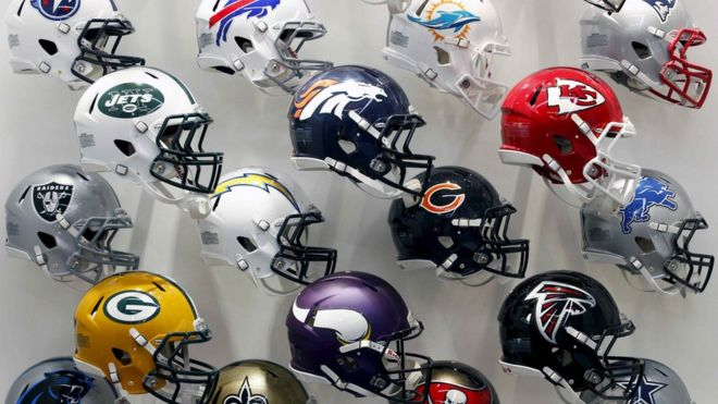 NFL team helmets are displayed at the NFL Headquarters in New York