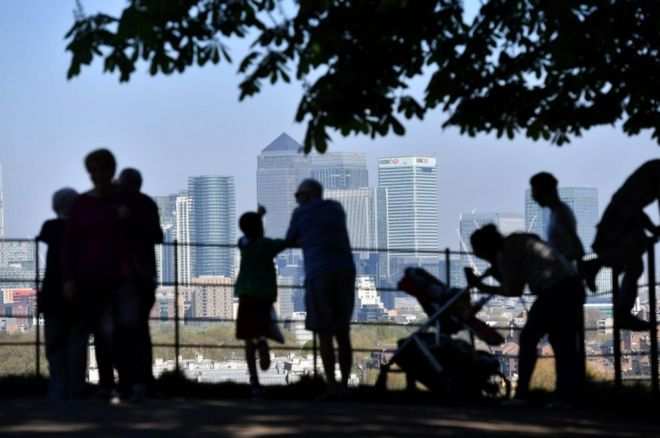 People look at Canary Wharf in London
