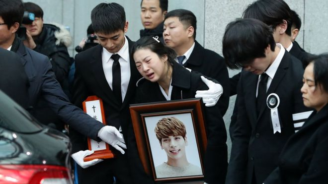 Relatives weep during the funeral of Jonghyun of SHINee at the hospital on December 21, 2017 in Seoul, South Korea. The lead vocal of K-pop idol found dead, thought to have committed suicide at his apartment on December 18.
