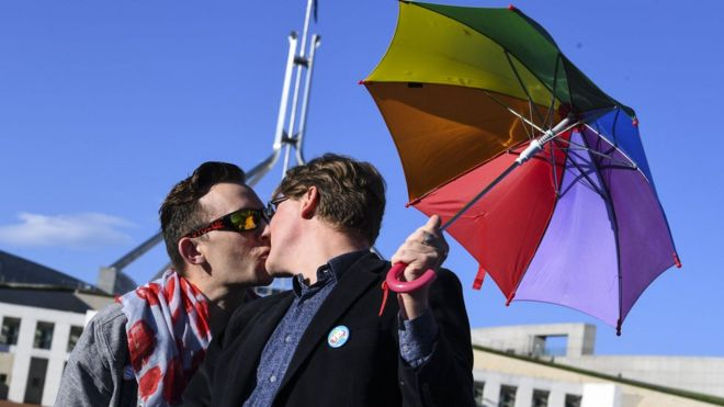 Same-sex marriage supporters outside Australia's parliament on Thursday